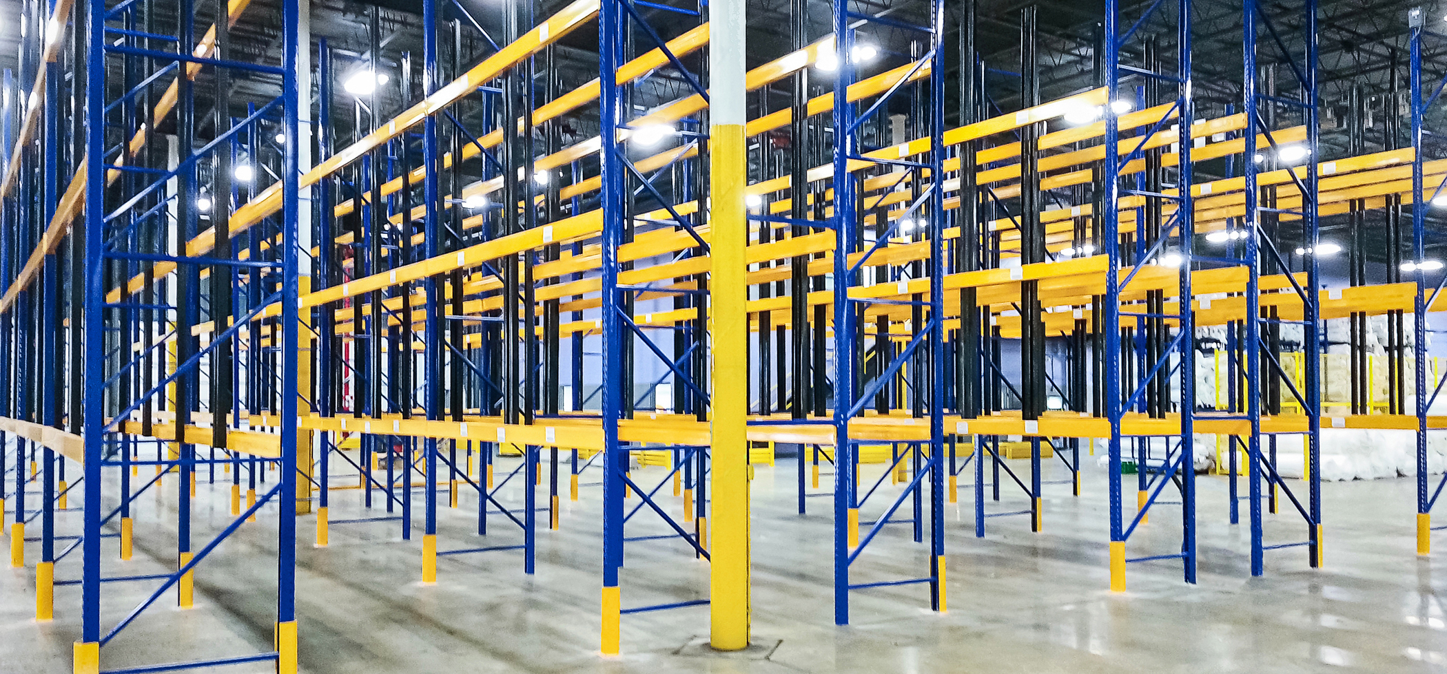 Custom colored galvanized pallet racks in a storage facility
