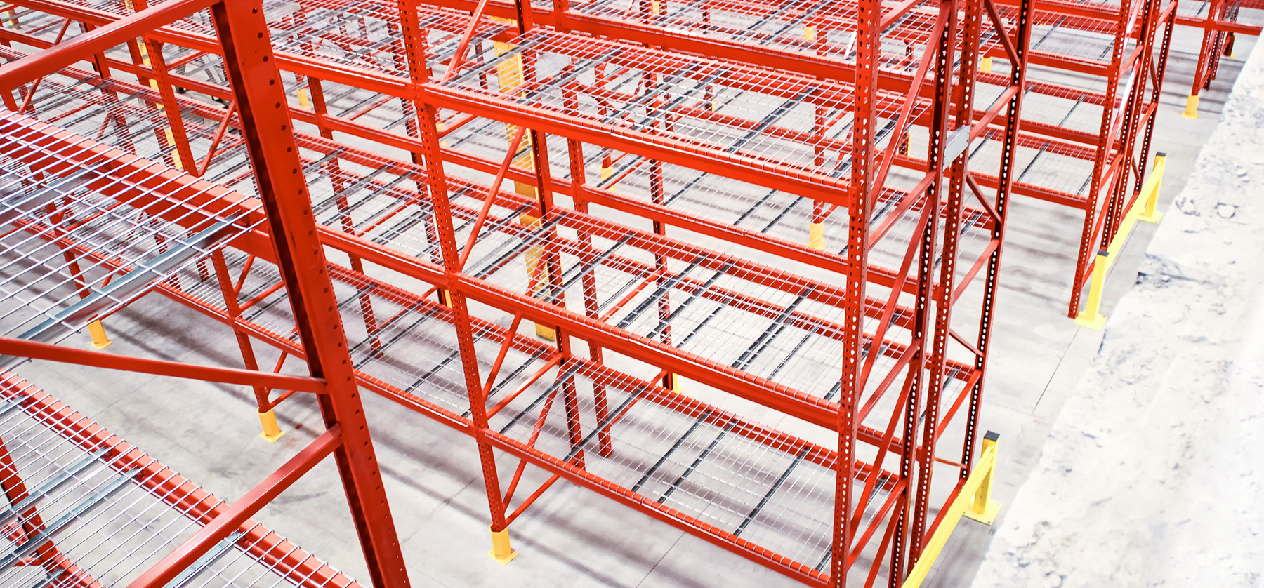 Custom colored galvanized pallet racks with post protectors, end of aisle guards, and mesh decking
