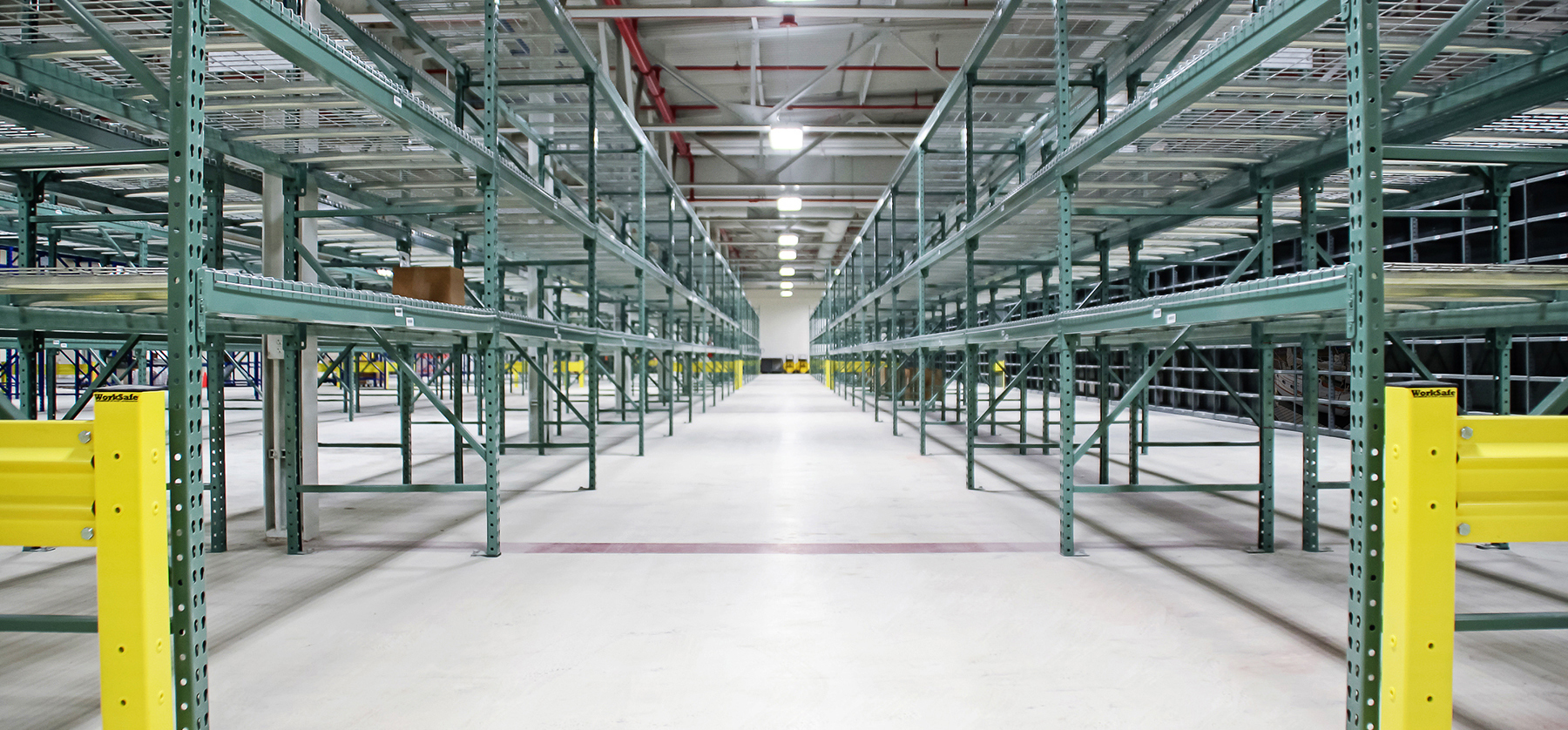 Warehouse with custom pallet racks, wire mesh decks, and safety equipment